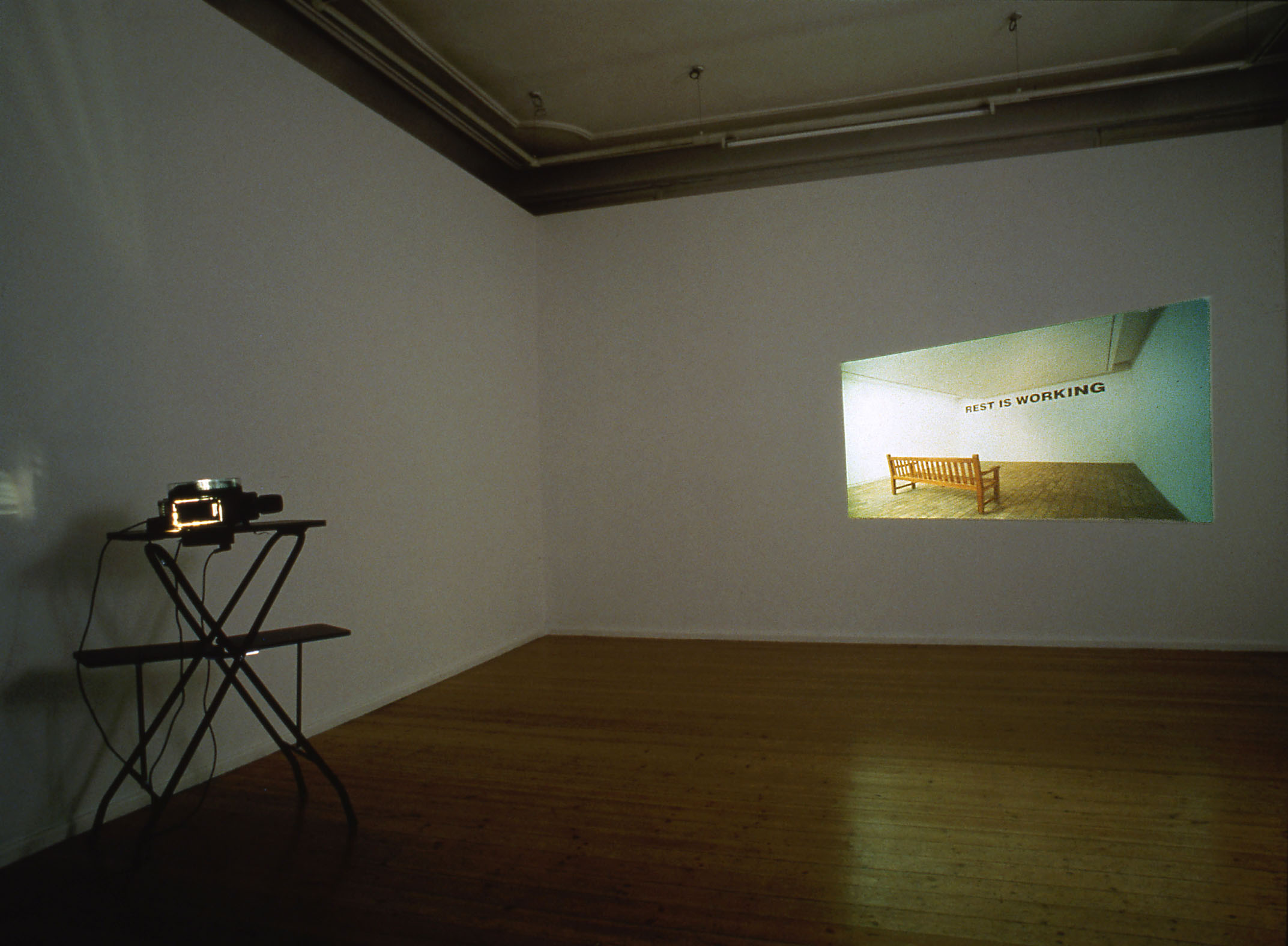 REST IS WORKING Art in Ruins 1992 Projector, stand, projection on wall CONCEPTUAL DEBT daadgalerie Berlin