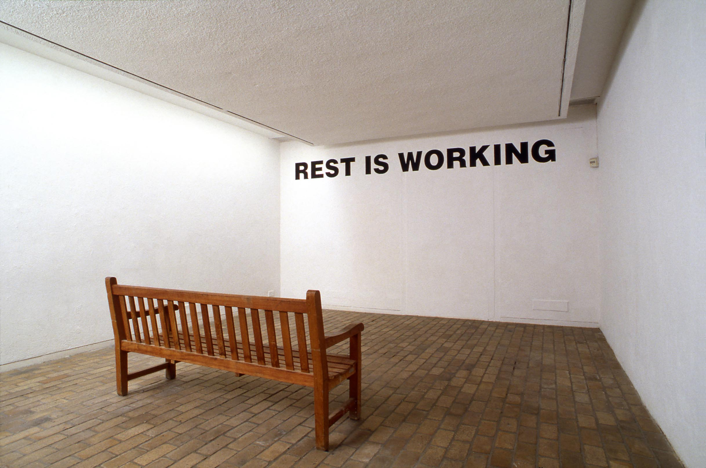 REST IS WORKING Art in Ruins 1991 Park bench, text on wall EXCAVATING THE PRESENT Kettle's Yard, Cambridge 1991