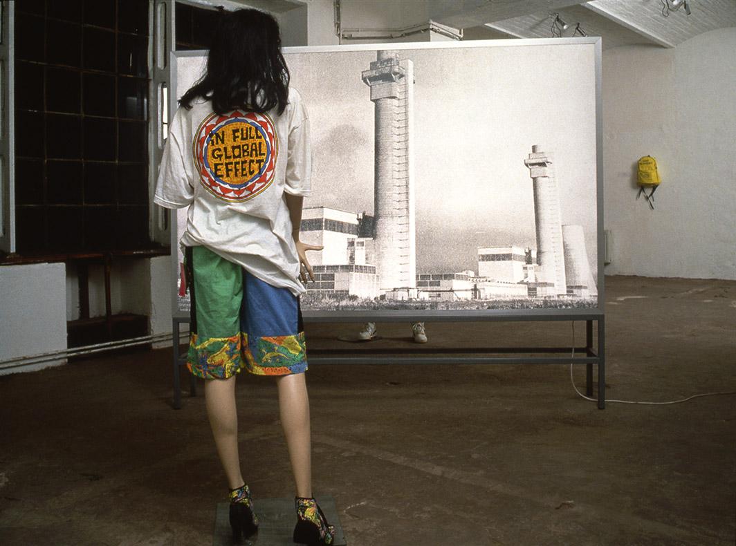 EQUIVALENT 1989 Art in Ruins Double-sided lightbox, mannikins, fluorescent sportswear Installation Likör Fabrik, 37 Räume, KunstWerke, Berlin 1992